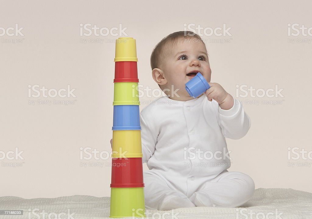 A baby playing with building toys royalty-free stock photo