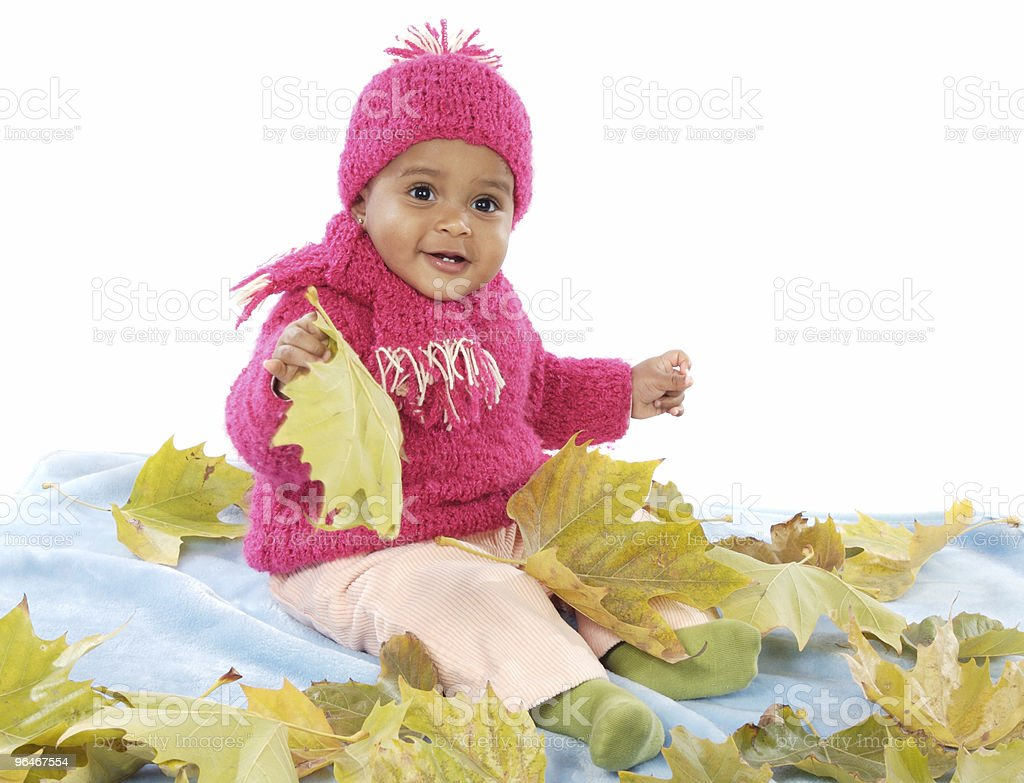 Baby playing with leaves royalty-free stock photo