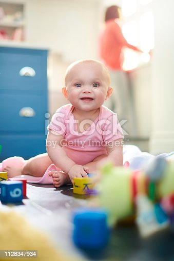baby playing with letter blocks