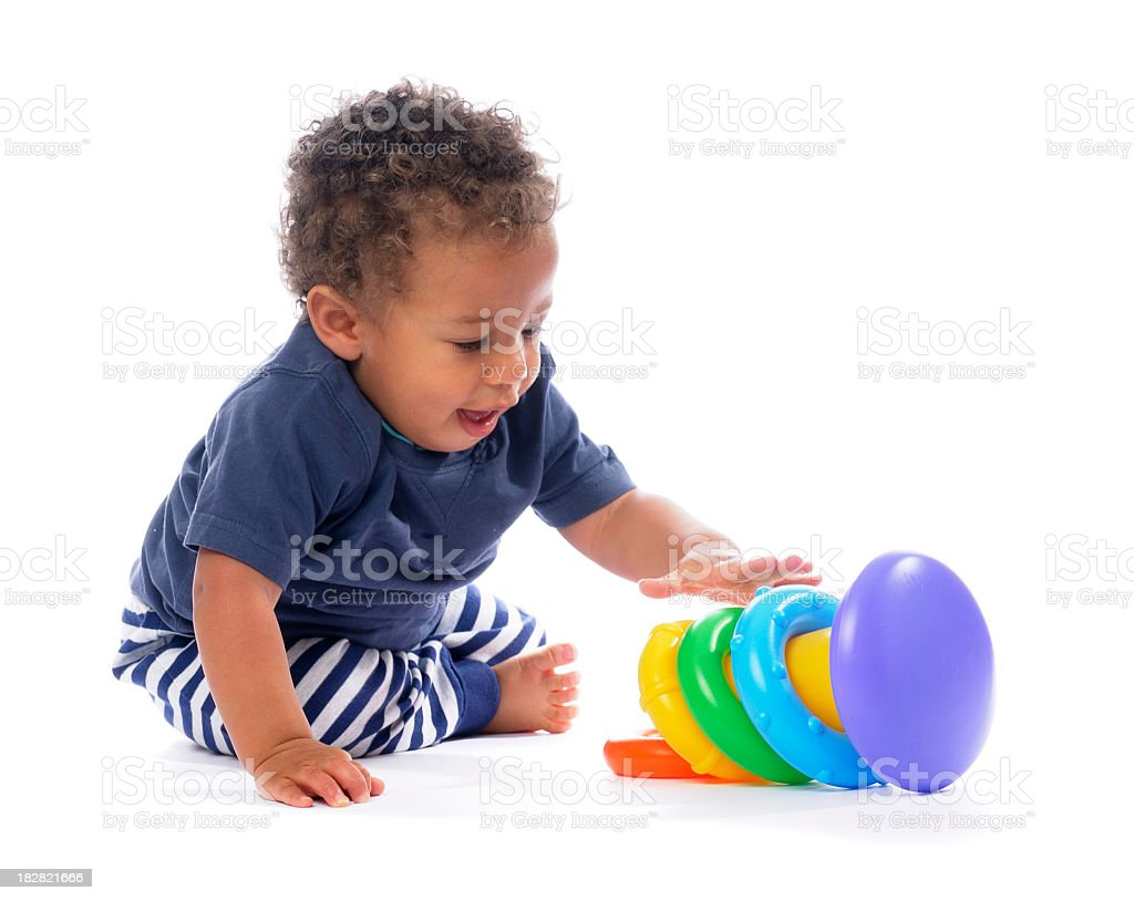 Baby Playing With Multi Coloured Rings/ Stacker Toy royalty-free stock photo