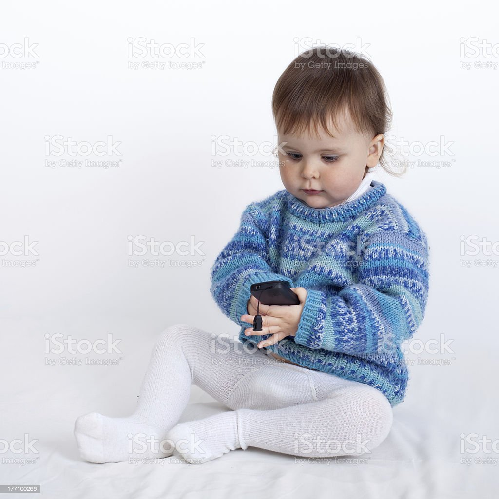 Baby playing with phone royalty-free stock photo
