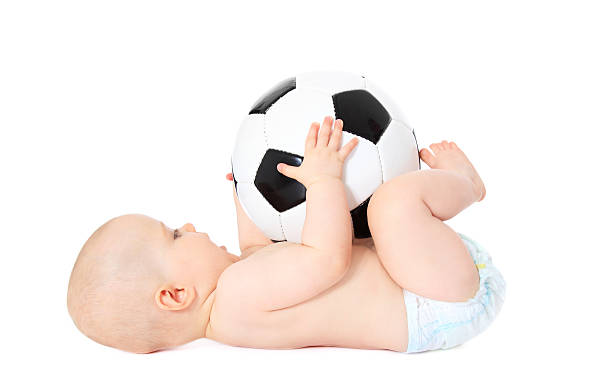 Baby playing with soccer ball stock photo