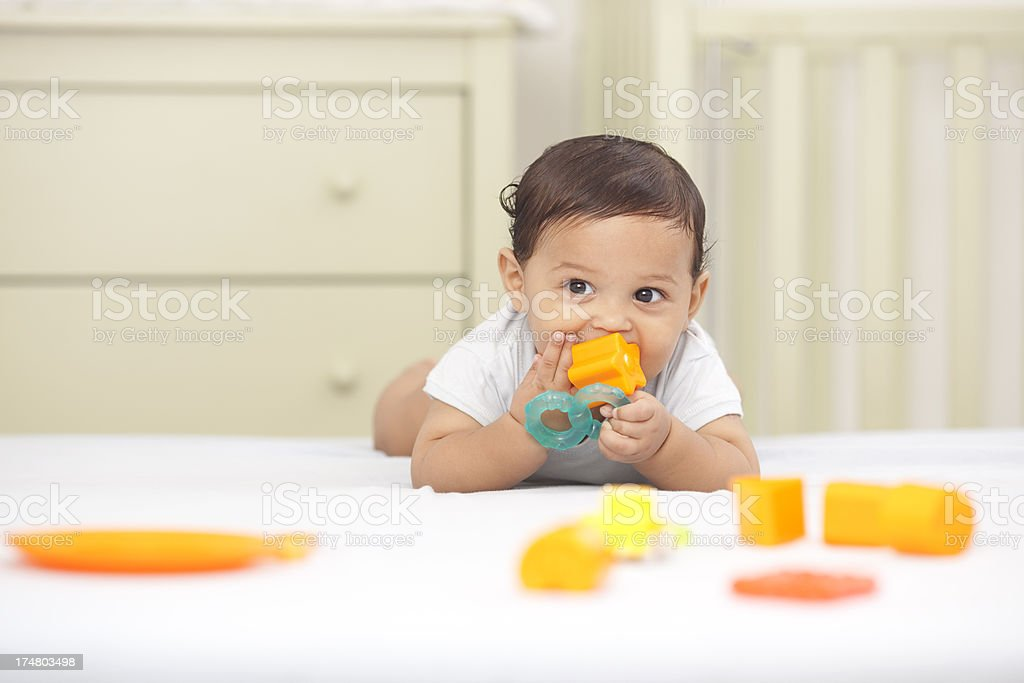 Baby playing with toys. stock photo