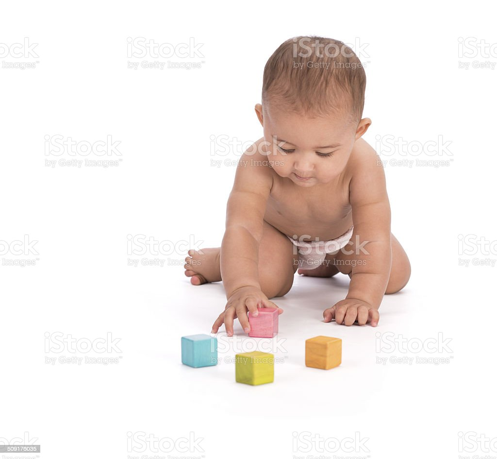 Baby playing with wooden blocks. stock photo