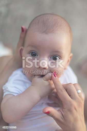 istock Baby Plays with Fingers 483316998