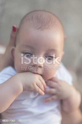 istock Baby Plays with Fingers 483317002
