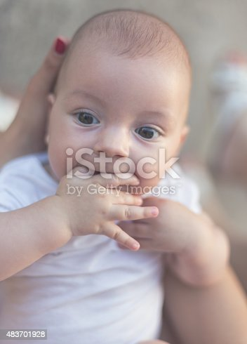 istock Baby Plays with Fingers 483701928