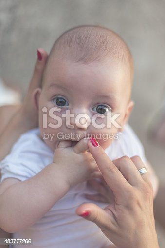 istock Baby Plays with Fingers 483777266