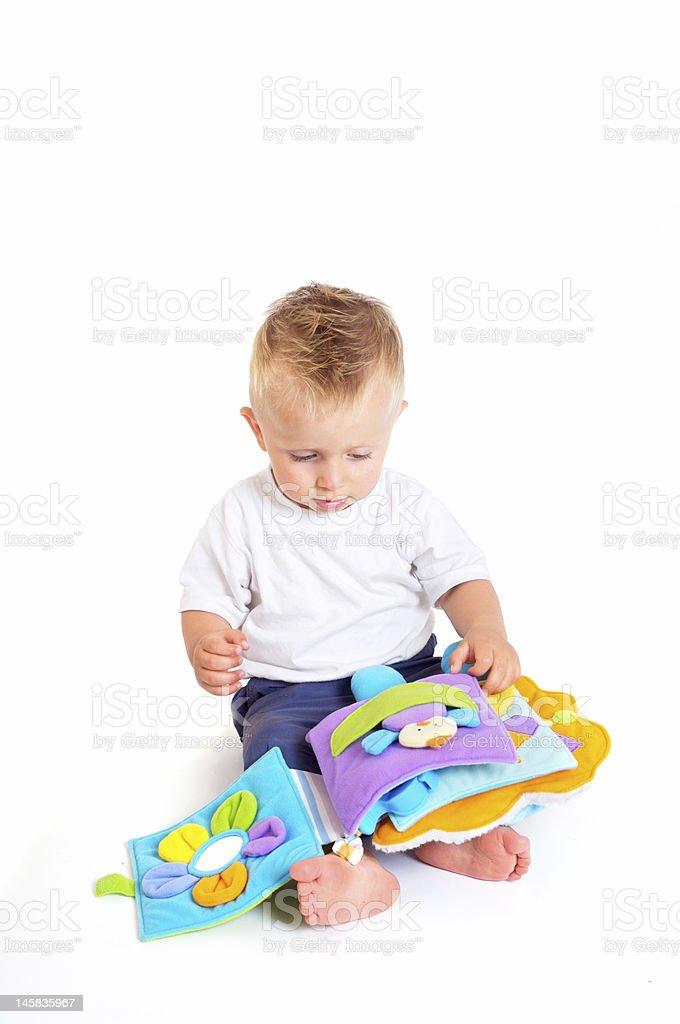 Baby plays with toys royalty-free stock photo