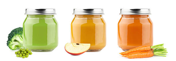 Baby puree with fruits and vegetables stock photo