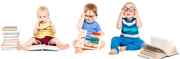 Baby Reading Book, Kids Early Education, Smart Children group in Glasses stock photo