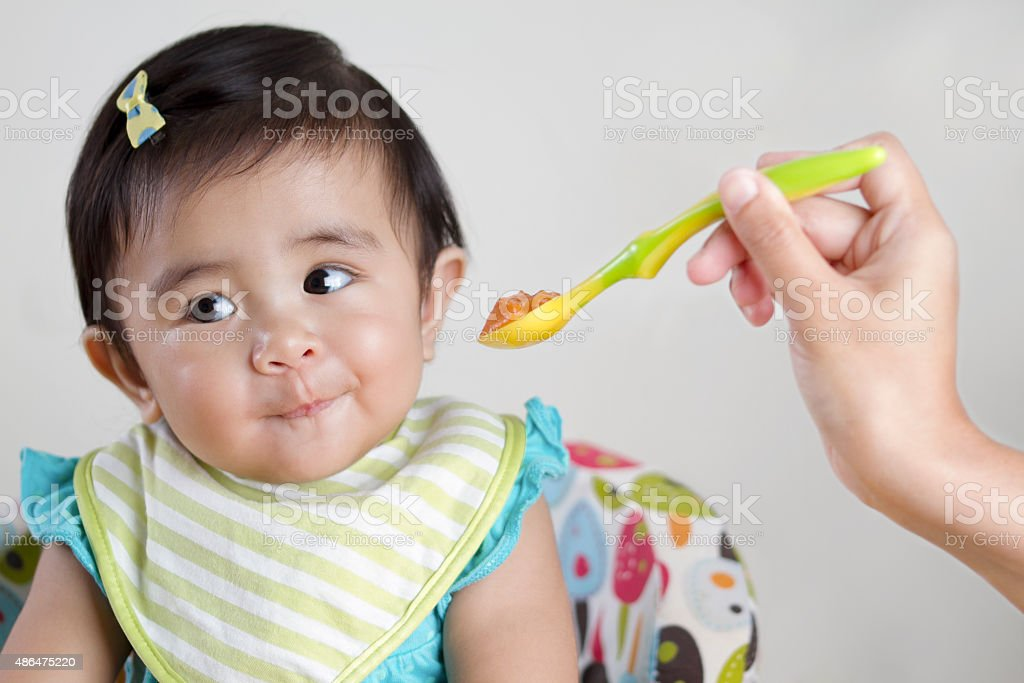 Baby rejecting food stock photo