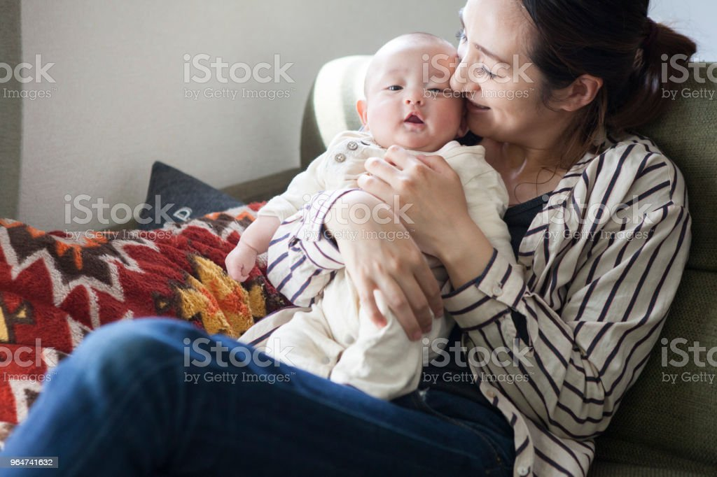 A baby resting with a mother hugged. royalty-free stock photo