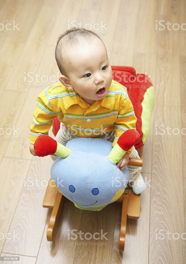 baby ride a toy royalty-free stock photo