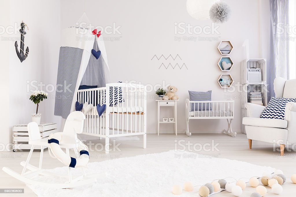 Baby room decorated in marine style stock photo