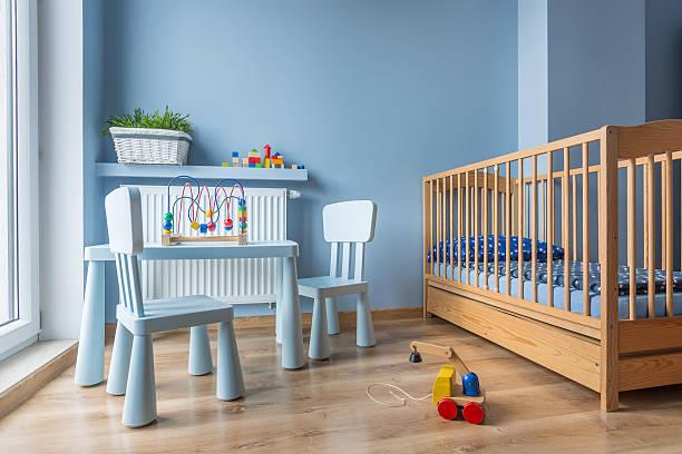 baby room in light blue color - heizraum stock-fotos und bilder