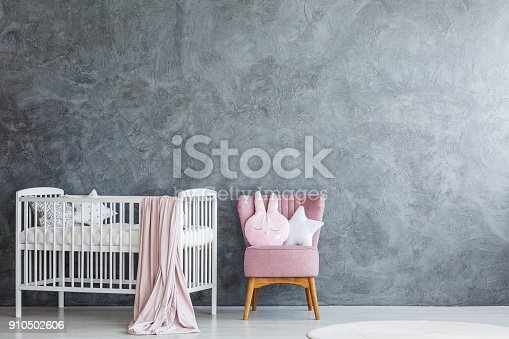 istock Baby room with crib and armchair 910502606