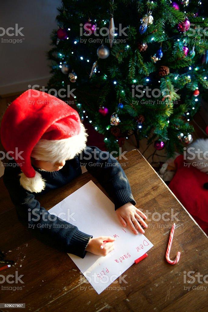baby Santa von oben betrachtet Weihnachten Brief schreiben – Foto