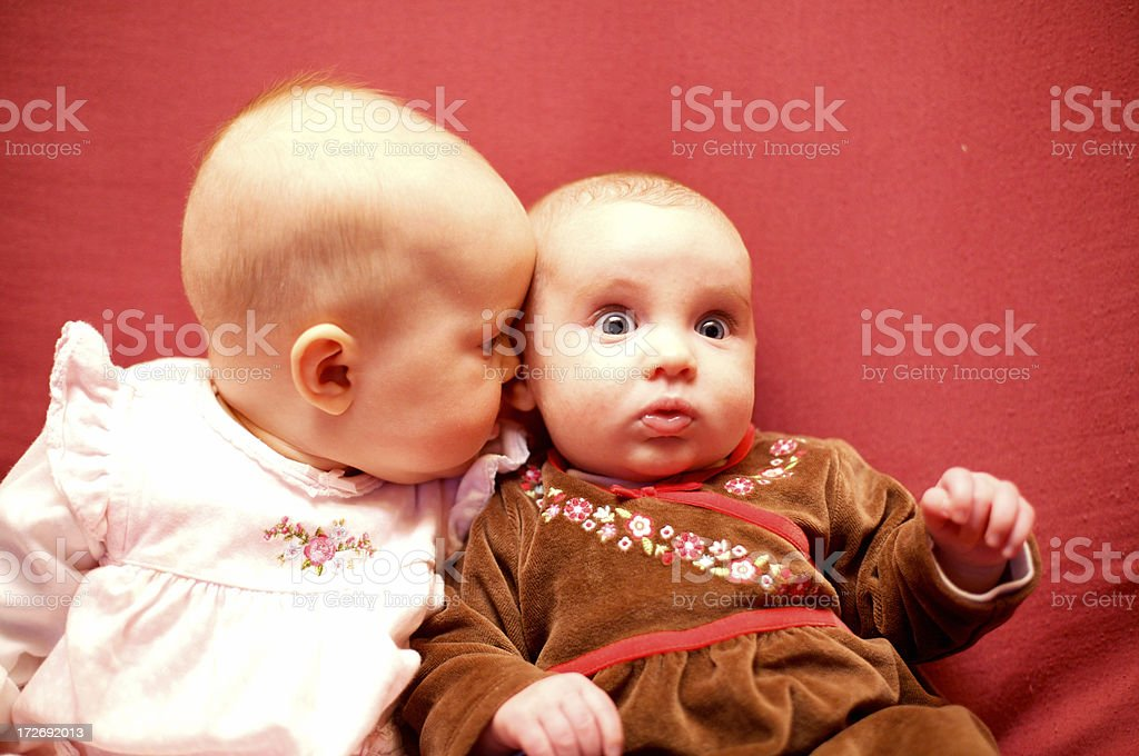 Baby saying a weird secret ! royalty-free stock photo