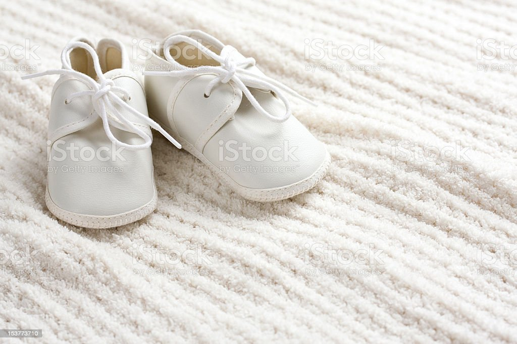 Baby shoes and blanket stock photo