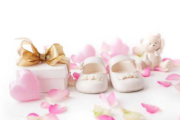 baby shoes and gift stock photo
