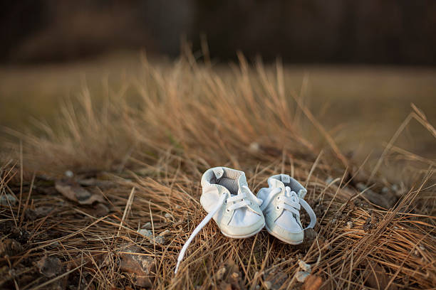 baby shoes in nature stock photo