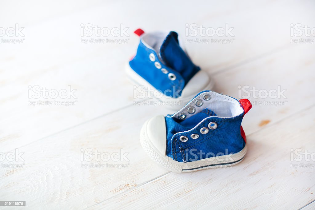 Baby shoes on wood background stock photo