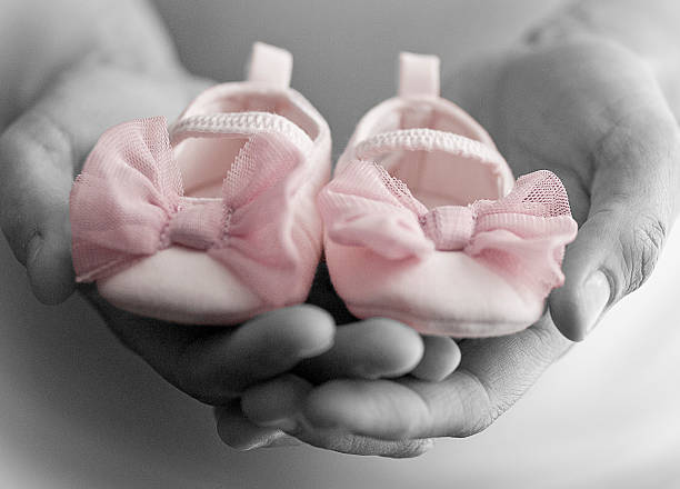 baby shoes - its a girl stock photos and pictures