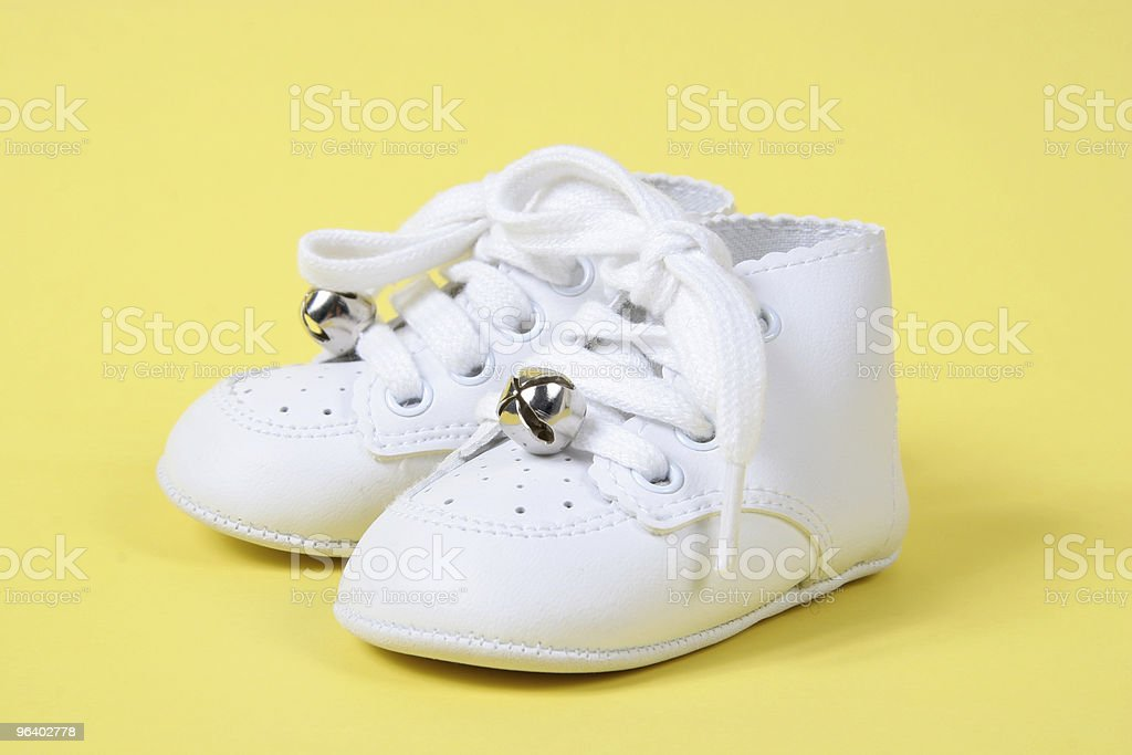 Baby Shoes Together on Yellow - Royalty-free Abstract Stock Photo