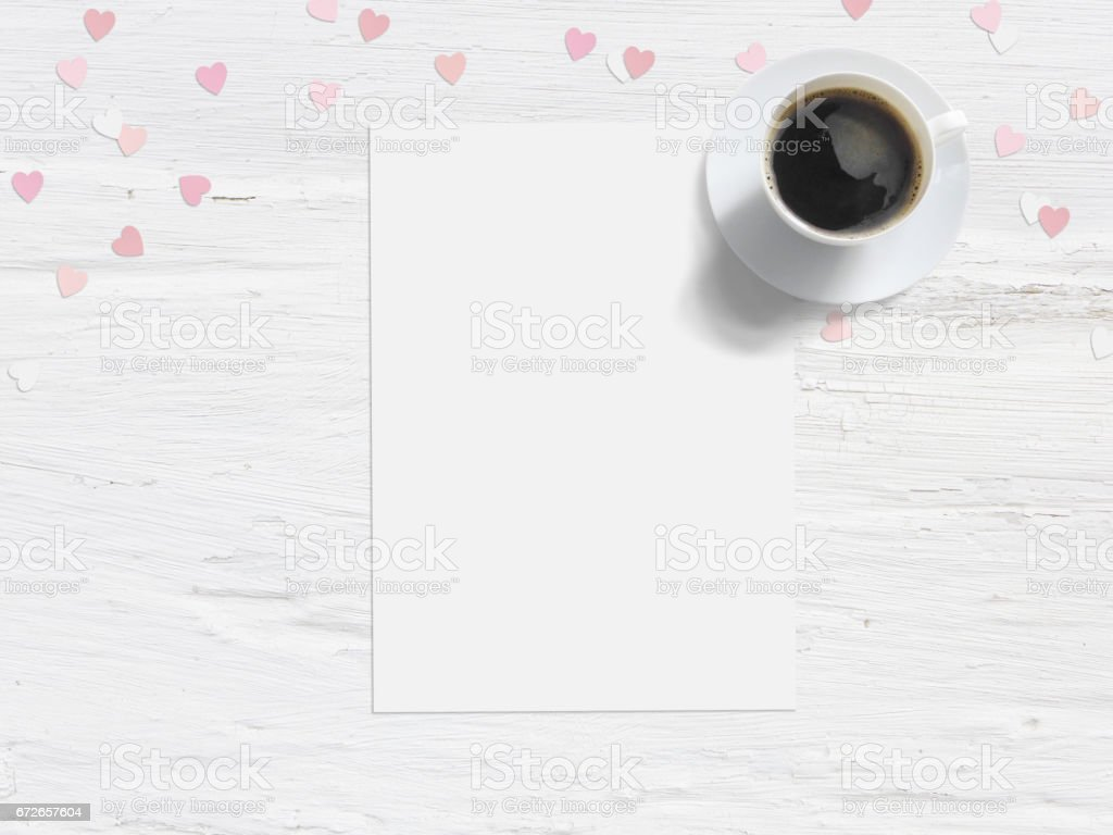 Baby shower, birthday day or wedding mockup scene with blank card, cup of coffee and paper heart confetti. Grunge white flat lay background. Top view stock photo