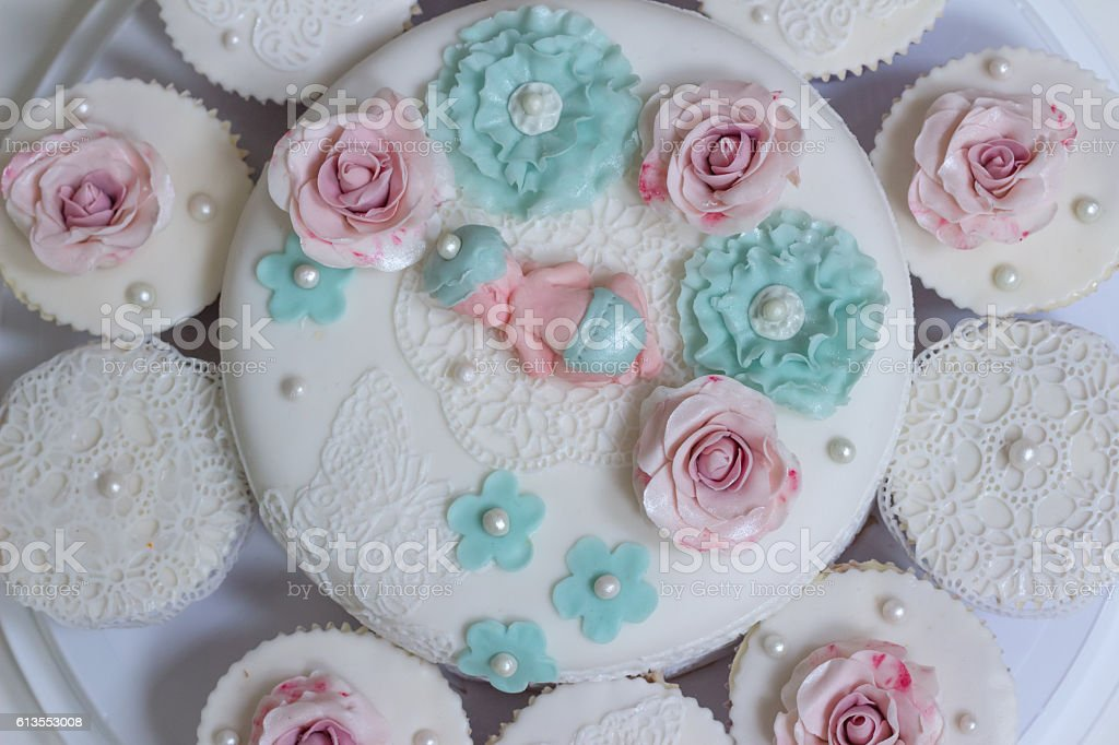 Baby shower cake and cupcakes stock photo