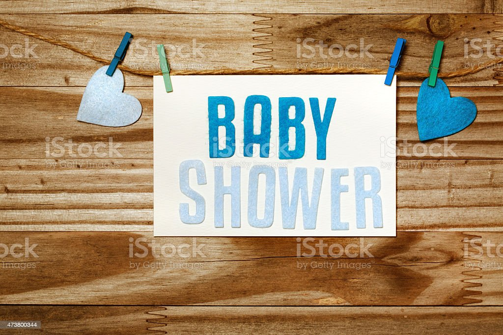 Baby shower card hanging with clothespins stock photo