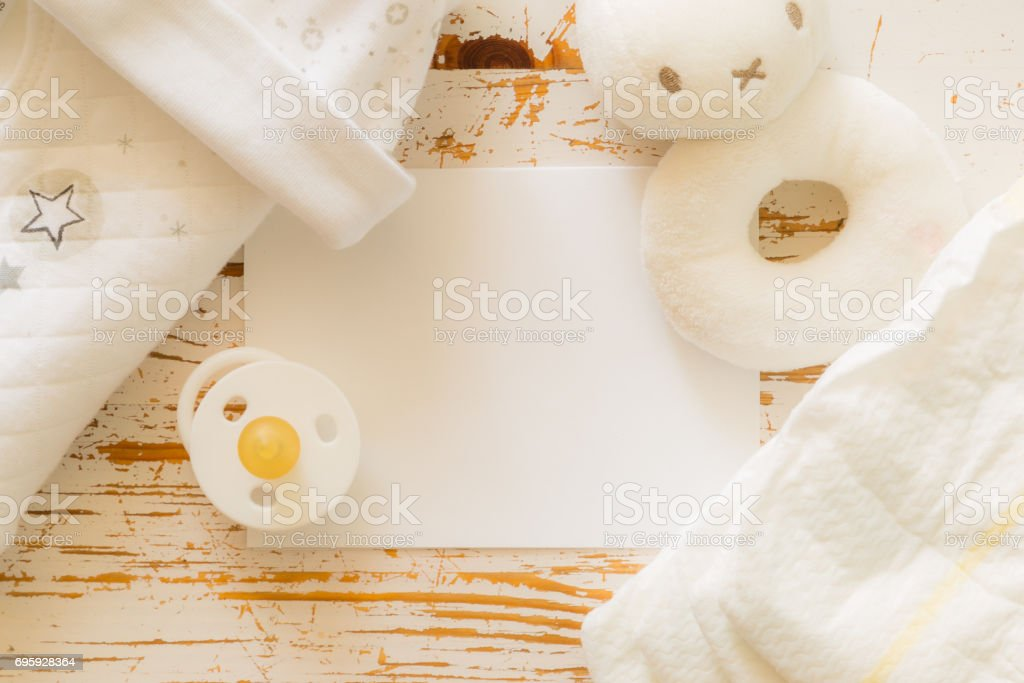 Baby shower concept - child essencials on wood background stock photo