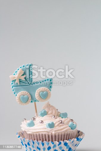 886700726istockphoto Baby shower cupcake for a boy. Newborn announcement concept. Text space 1130857746