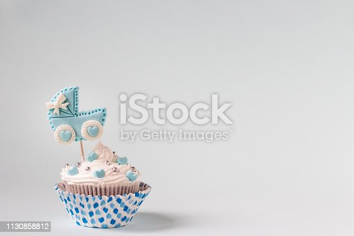 886700726istockphoto Baby shower cupcake for a boy. Newborn announcement concept. Text space 1130858812