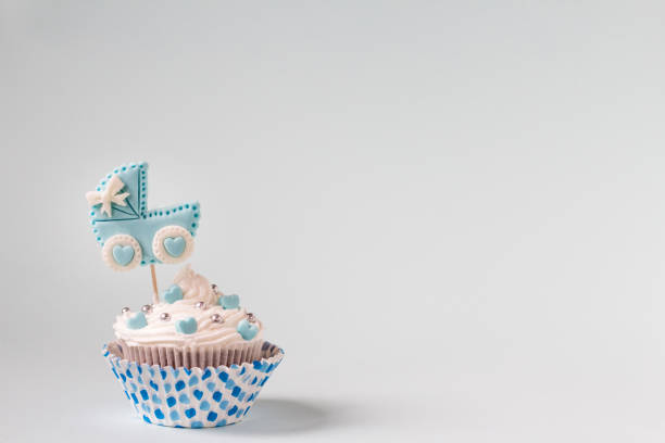 Baby shower cupcake for a boy. Newborn announcement concept. Text space Baby shower cupcake. Welcome baby boy concept. Newborn announcement. Text space sentimentality stock pictures, royalty-free photos & images