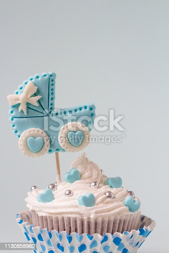 886700726istockphoto Baby shower cupcake for a boy. Newborn announcement concept. Text space 1130858962