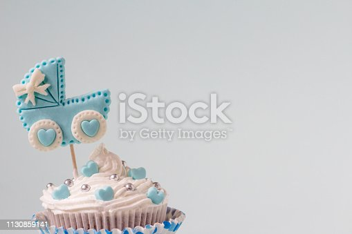 886700726istockphoto Baby shower cupcake for a boy. Newborn announcement concept. Text space 1130859141
