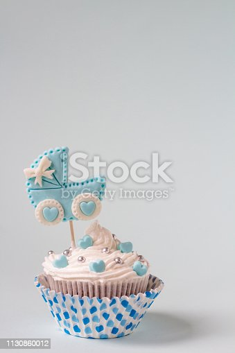 886700726istockphoto Baby shower cupcake for a boy. Newborn announcement concept. Text space 1130860012