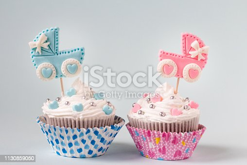 886700726istockphoto Baby shower cupcake for a girl and a boy. Newborn announcement concept. 1130859050