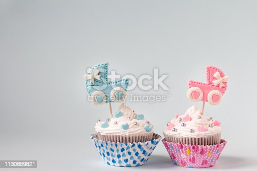 886700726istockphoto Baby shower cupcake for a girl and a boy. Twins newborn announcement. Text space 1130859821
