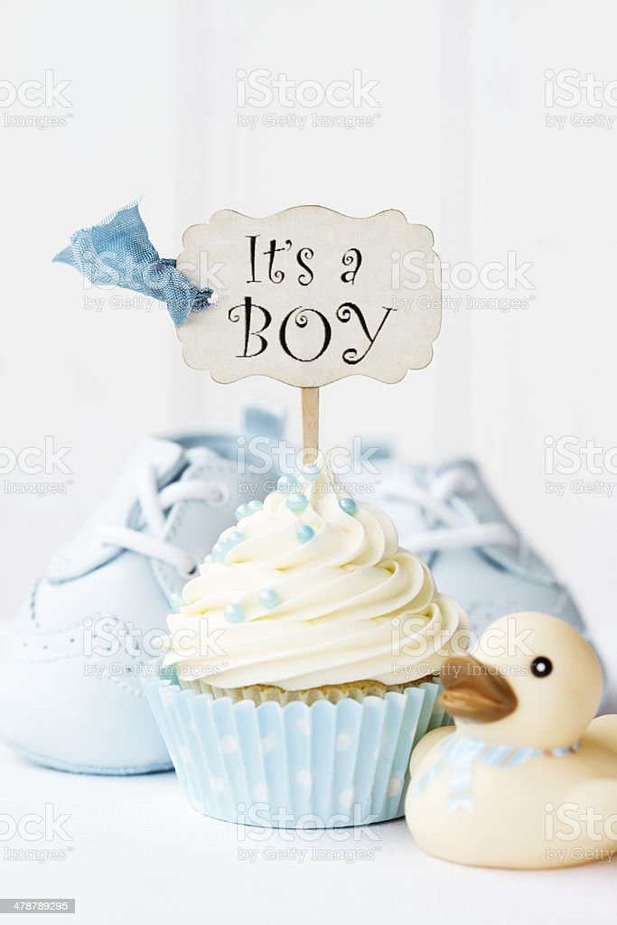 "Baby shower cupcake Cupcake with ""it's a boy"" pick Baby Booties Stock Photo"