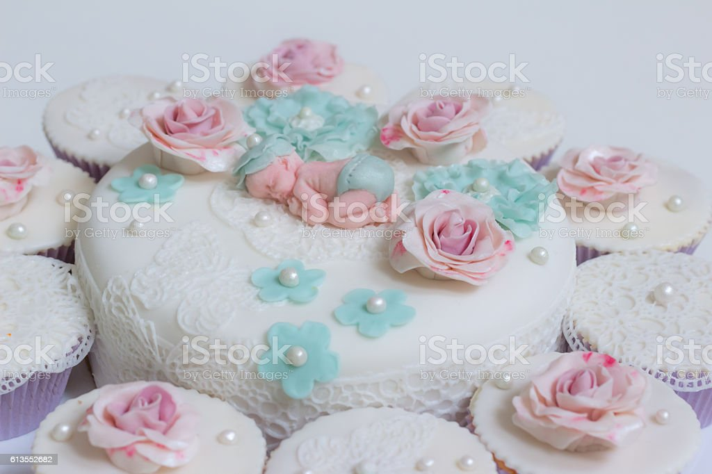 Babyshower cake and cupcakes with a baby girl or boy, decorated with...