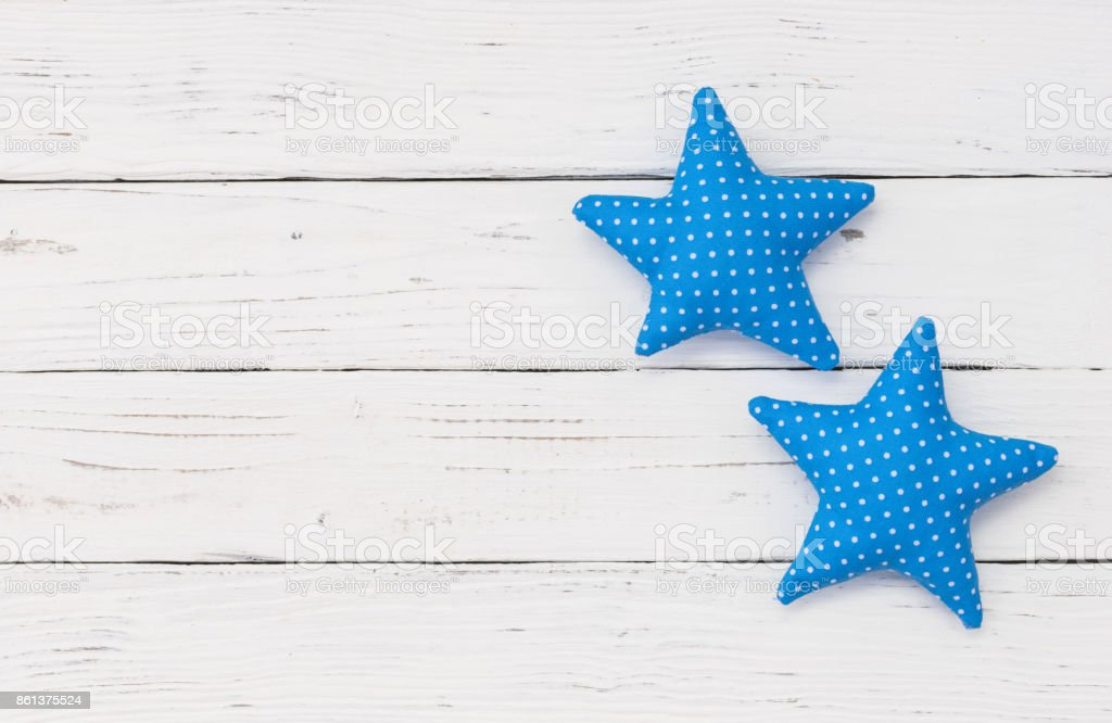 Baby shower for a boy, with blue star shapes stock photo