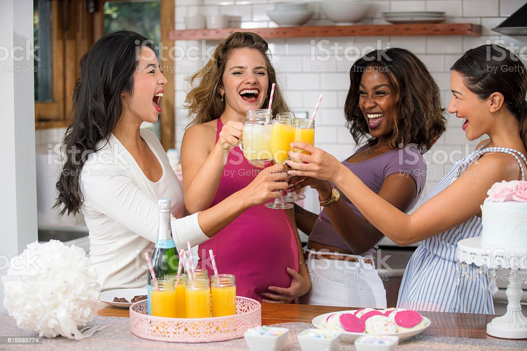 Baby shower fun mimosa cocktail diverse group women friends ethnicities - Photo