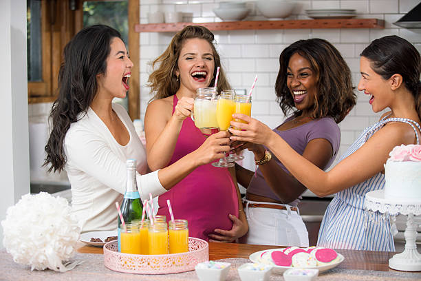Baby shower fun mimosa cocktail diverse group women friends ethnicities stock photo