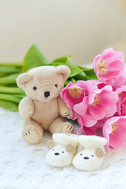 babydusche mädchen - geschenk zur taufe stock-fotos und bilder