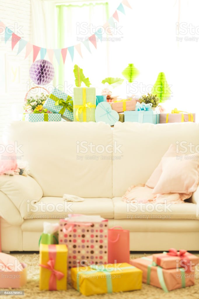 Baby shower party decorations and gifts in living room stock photo