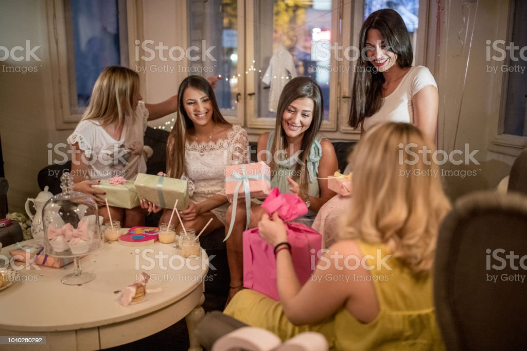 Pregnant woman and her friends at baby shower party