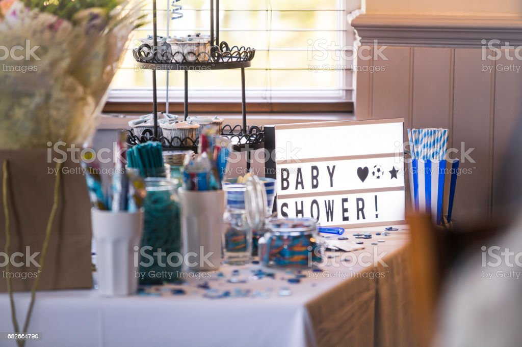 Baby Shower Sweet Table Table of sweets at a baby shower. They are trimmed with pale blue Baby Shower Stock Photo